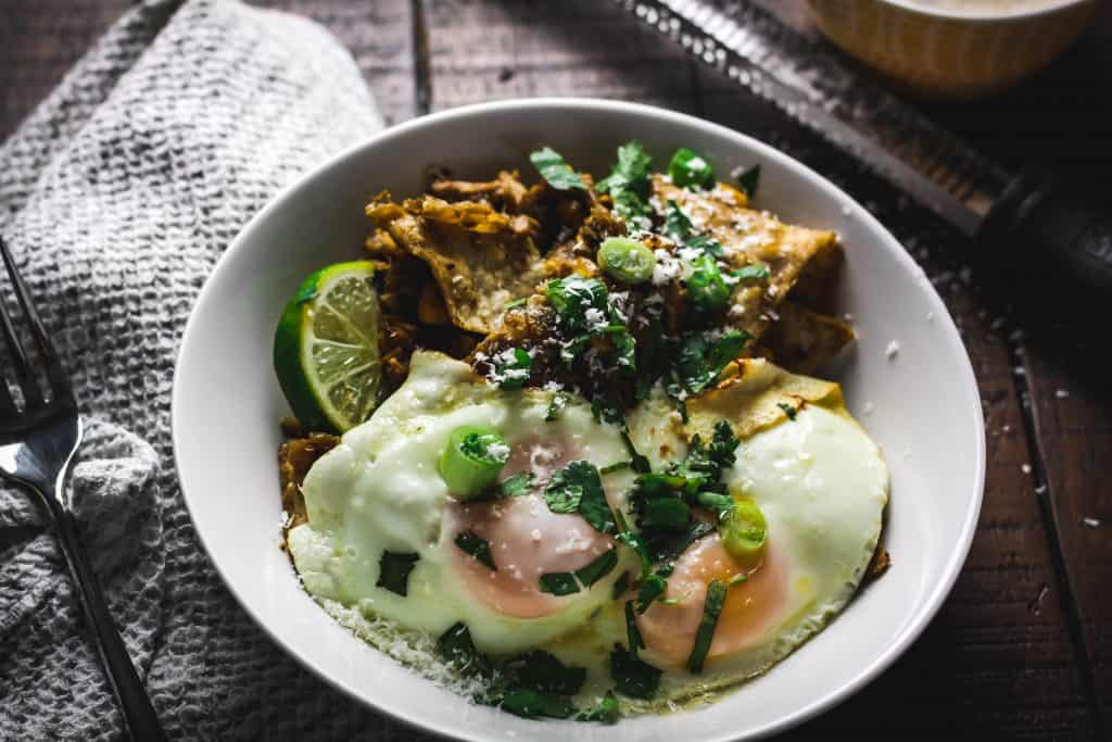 chilaquiles with fork and microplane