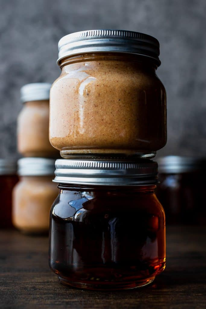 stacked mason jars with rum and butter mixture