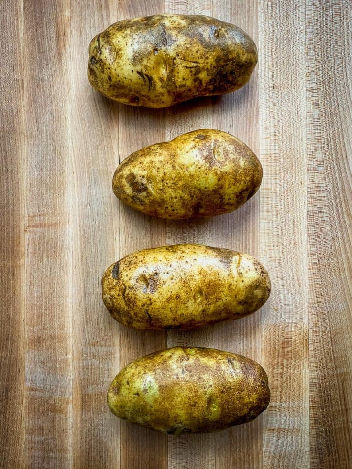 prepped potatoes sliced with a cross