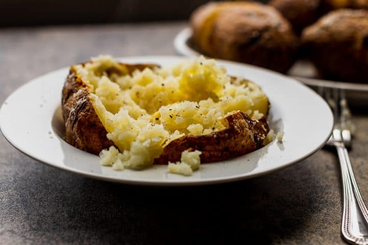 bowl of baked potato with salt and butter