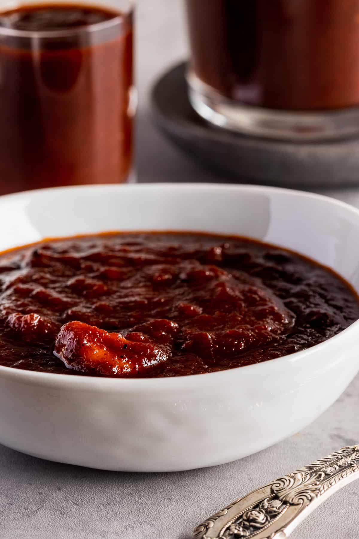 bowl of bbq sauce with clove of garlic visible