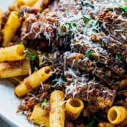 close up platter of rigatoni and sliced meat