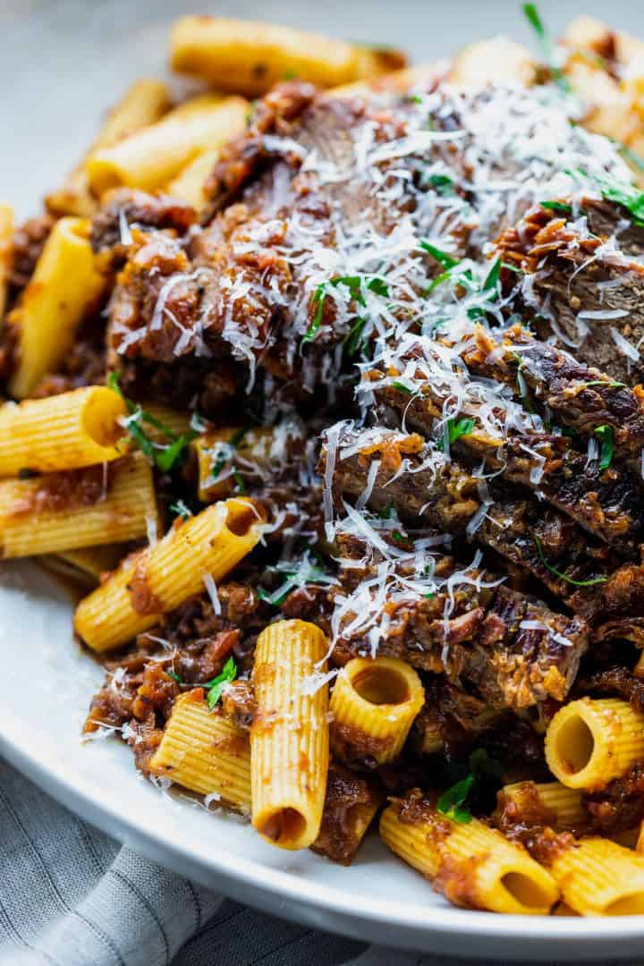 close up of a platter of pasta with the beef sliced