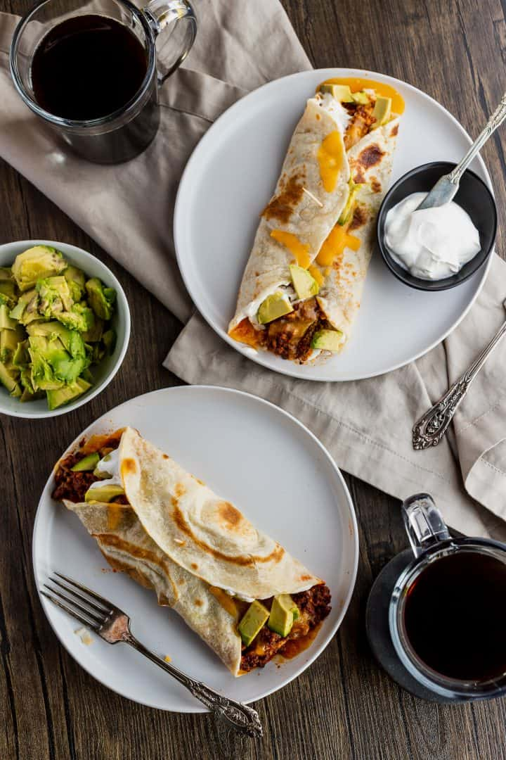overhead shot of a table set with burritos and coffee